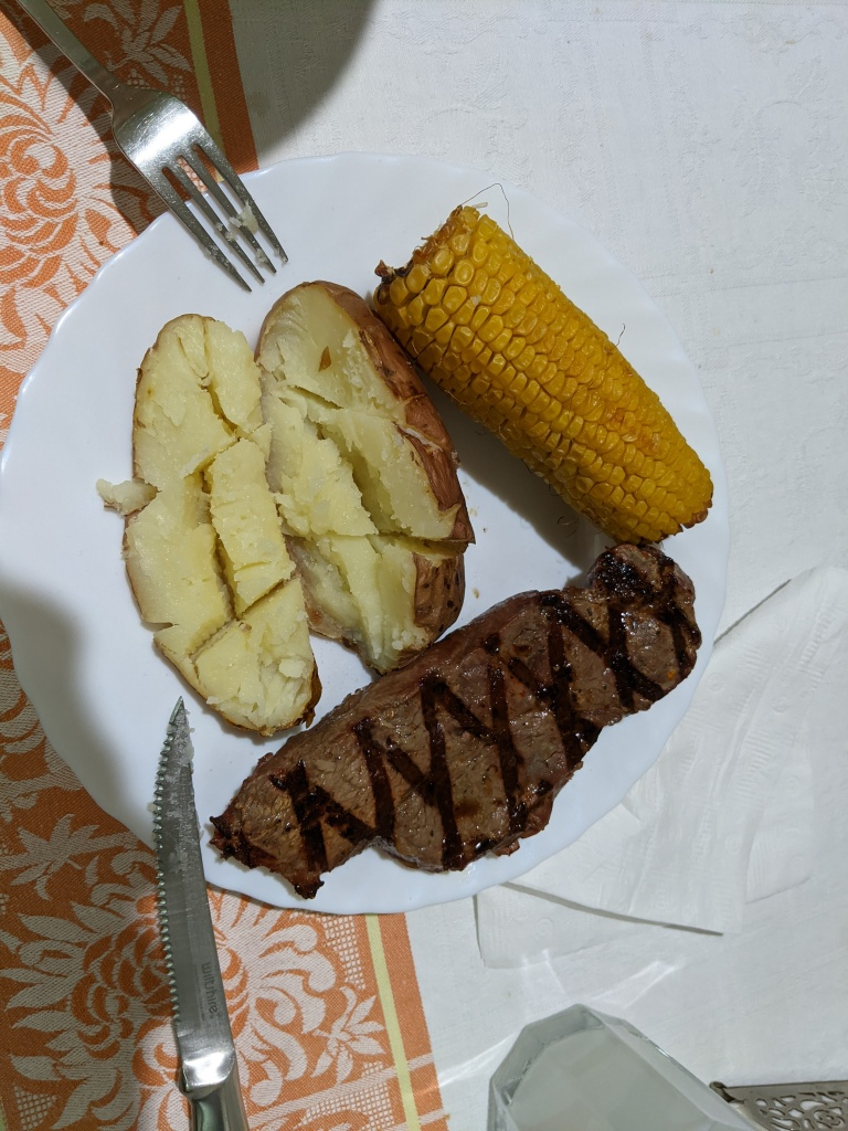 New York strip steak with corn and potato from the Traeger Ironwood 885